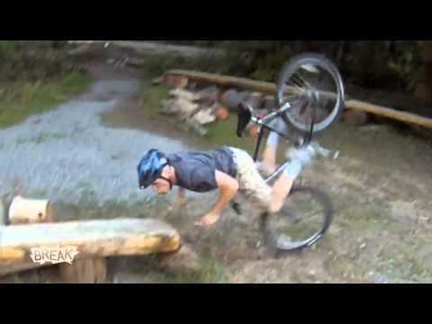 Mountain Biker - Mountain Biker Faceplants Into Log