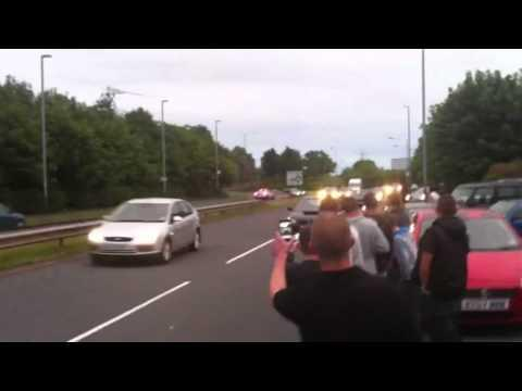 Boy racer - Boy racer tries to outrace police - on the wrong side of a dual carriageway