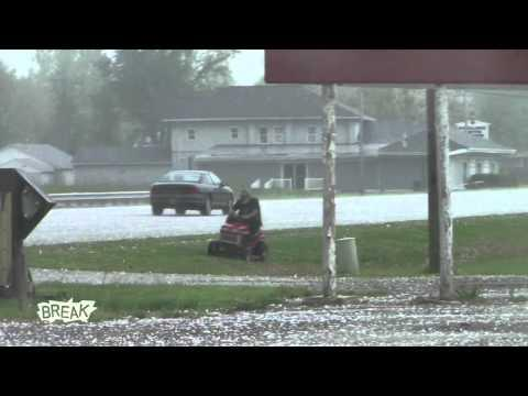 Epic Beard Man - Insane Man Mows Grass During Hail Storm